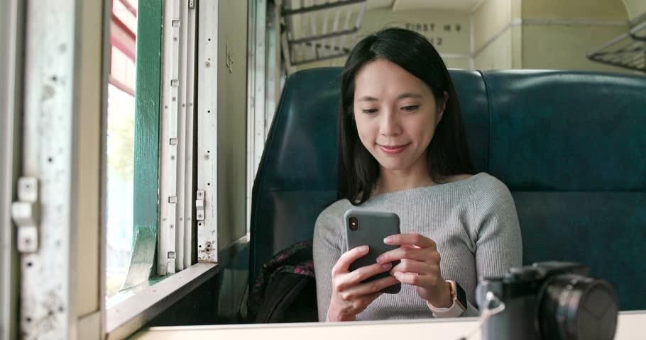 Woman work on cellphone on train | Shutterstock HD Video #1013342735