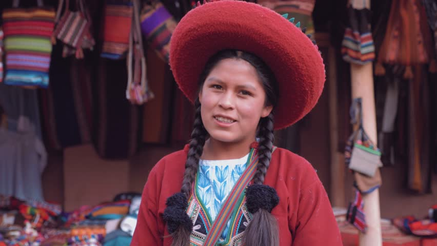 Portrait of Cute Peruvian girl smiling in slow motion