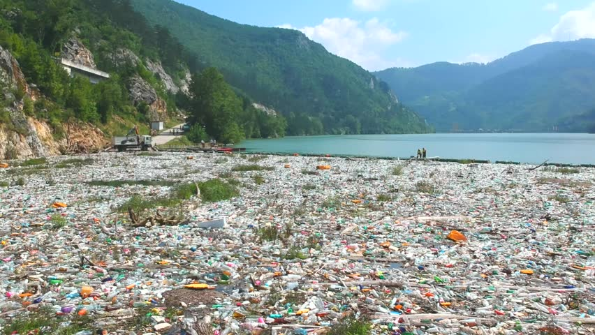 Plastic bottles in a polluted river water. Aerial view, drone view   Shutterstock HD Video #1013359631