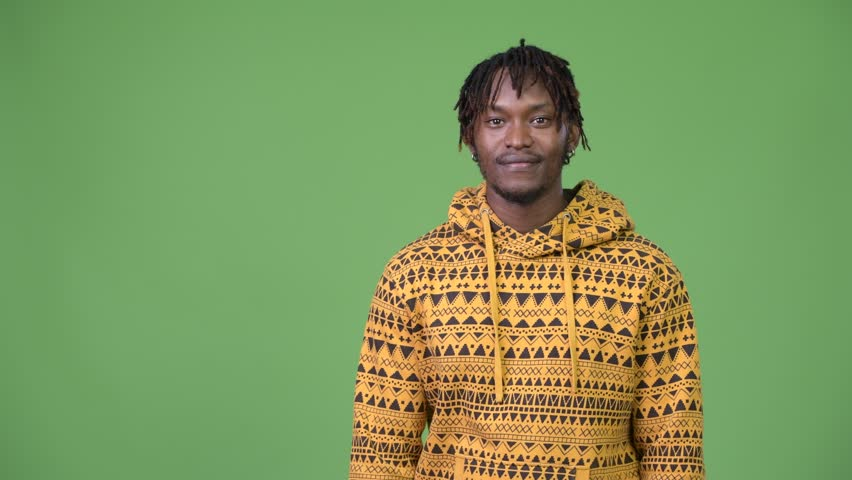 Young handsome African man showing something | Shutterstock HD Video #1013375996