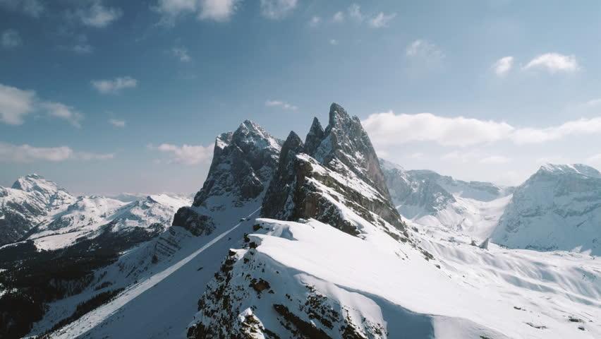 Aerial flight over The Dolomites, Italy in winter. Filmed in 4k. #1013381795