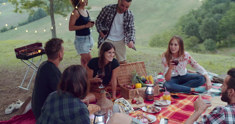 Group of friends spending time making a picnic and a barbeque. shot in slow motion | Shutterstock HD Video #1013400596