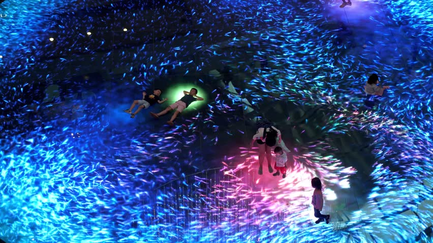 Singapore, 26 May 2018. Large screen augmented reality experience on the floor. Digital Light Canvas at Marina Bay Sands Science, people with their children have fun at it screen. 3840x2160, 4k