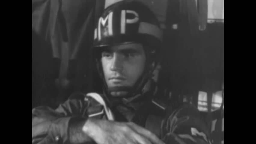 CIRCA 1953 - A montage shows some of the many responsibilities of the Military Police Corps. | Shutterstock HD Video #1013424455
