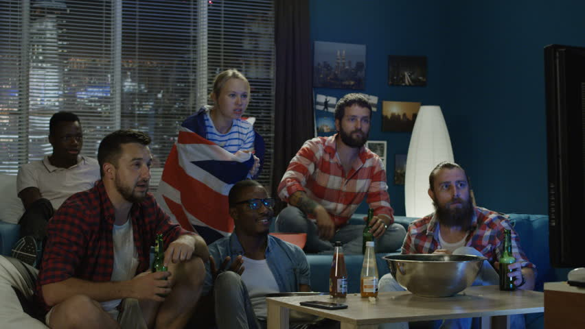 Multiethnic men and woman sport fans with British flag watching TV and having fail and unhappy with result | Shutterstock HD Video #1013428280