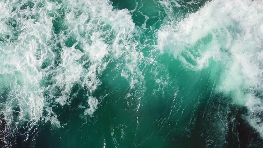 Sea waves breaking against  cliff viewed from above. #1013447939