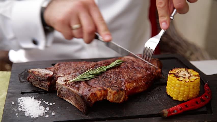 Serving steak in a restaurant. Black Angus | Shutterstock HD Video #1013496173