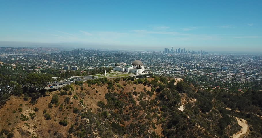 Aerial view of Griffith Observatory and downtown of Los Angeles, California Royalty-Free Stock Footage #1013535179