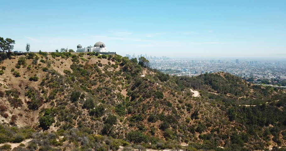 Aerial view of Griffith Observatory and downtown of Los Angeles, California Royalty-Free Stock Footage #1013535182