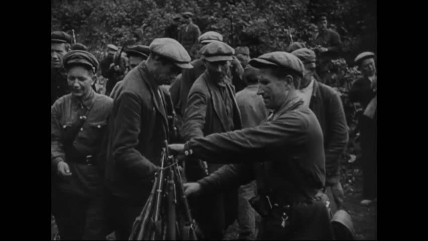 CIRCA 1941 - Soviet men and women make up a guerrilla army, fighting the invading Nazis (narrated in 1943).