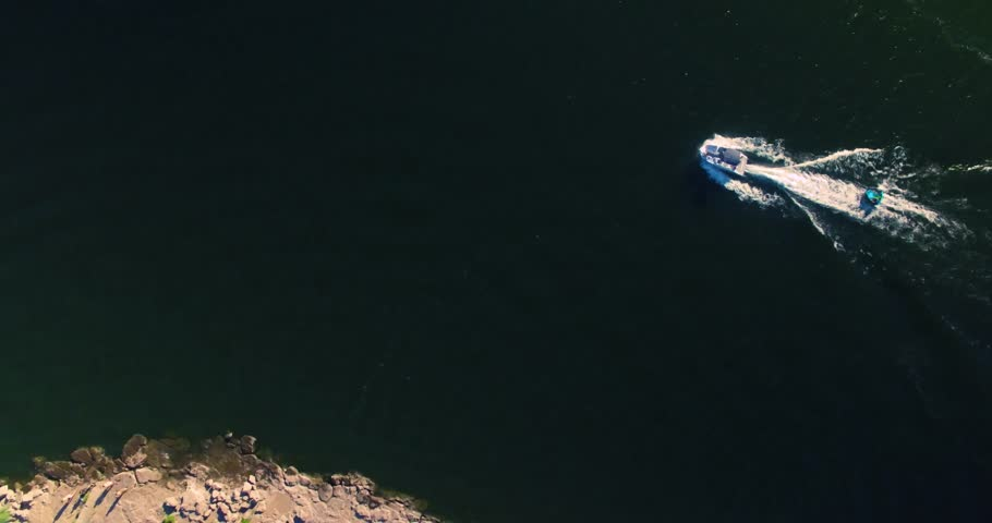 Slow motion aerial footage of people on boats in a river  | Shutterstock HD Video #1013539346