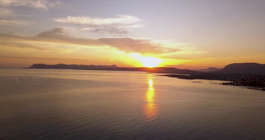 Beautiful sunrise in Agia Marina. Flying above the water with a stunning coastline view of the Crete island. | Shutterstock HD Video #1013546258
