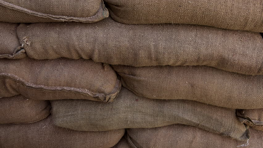 Pan shot of sandbags stacked up 4K