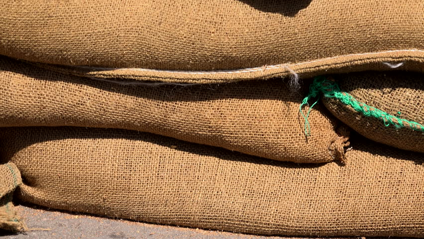 Close up shot of sandbags on a pile making wall or barrier 4K