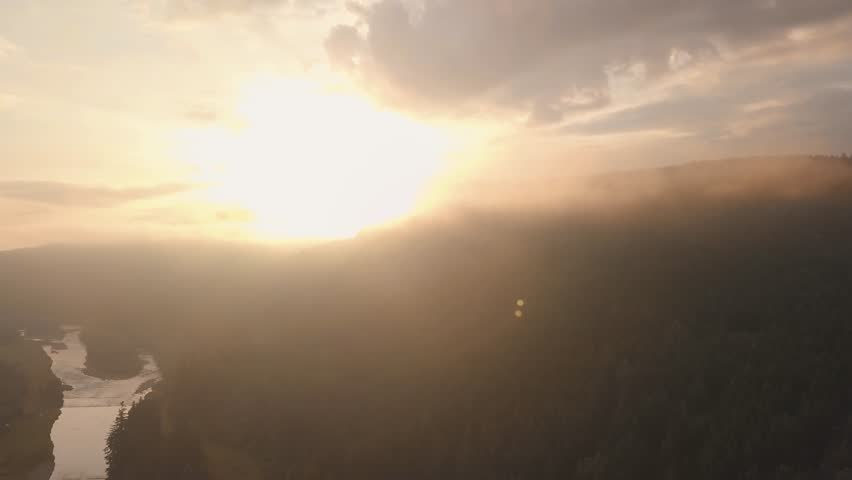 Sunset in mountings. Aerial view. Fog | Shutterstock HD Video #1013553338
