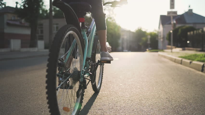 Girl Kid Riding Bike in Summer in City at Beautiful Sunset  in Slow Motion | Shutterstock HD Video #1013554694