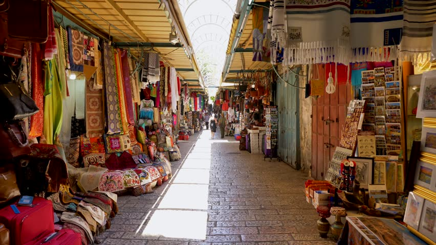 Jerusalem, Israel - July 9, 2018: People at Jerusalem old city market - Walking footage.  Everything from Jewelry and ceramics to fresh traditional food can be found in this market.