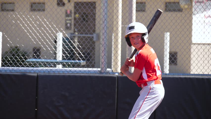 Slow motion video of youth baseball player hitting a home run