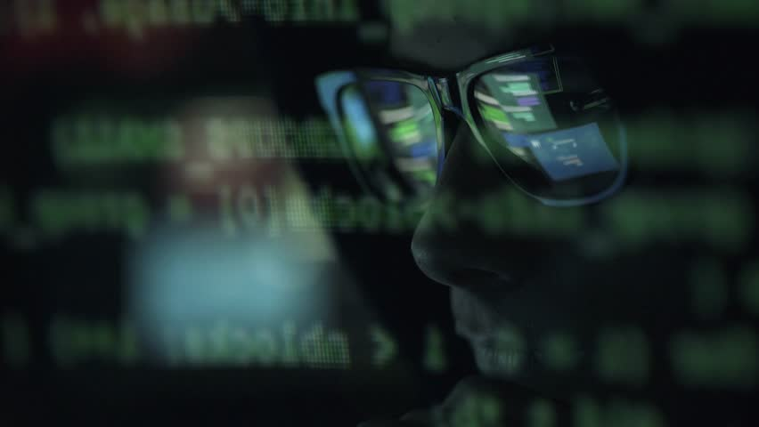Young nerd hacker with glasses connecting online and stealing data, cyber crime and hacking concept | Shutterstock HD Video #1013580557