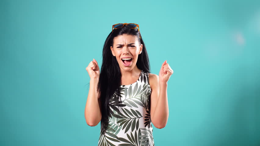 Portrait of beautiful model isolated on the pink background. Giggling girl. ha-ha | Shutterstock HD Video #1013580941