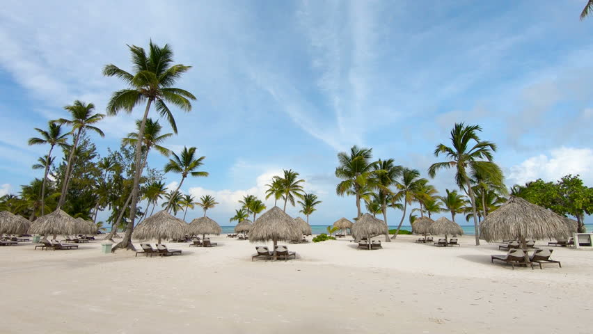 The best beaches in the world. Hawaiian Islands / Sun umbrellas on the beach with white sand. deck chair, lounge, recliner, daybed, chaise-longue, sun lounger and the blue sea | Shutterstock HD Video #1013597078