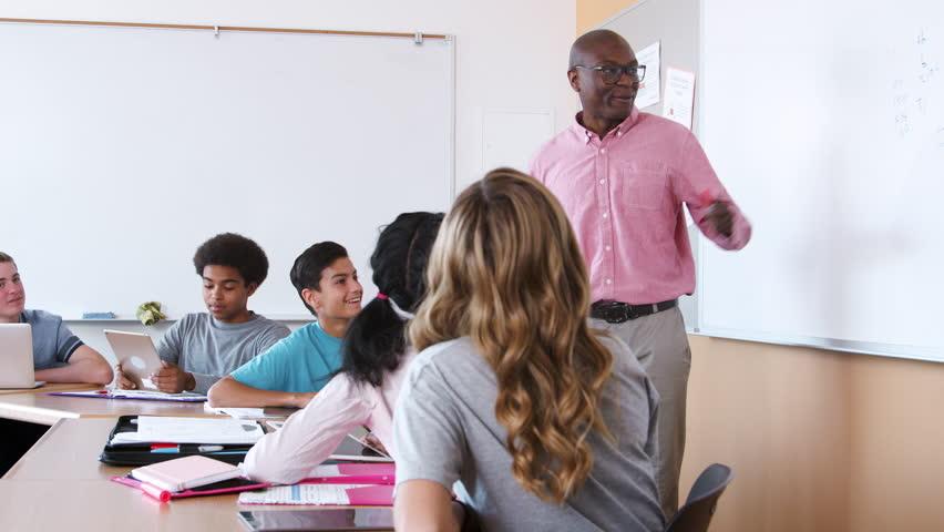 Female High School Pupil Writing On Whiteboard In Maths Class | Shutterstock HD Video #1013599694