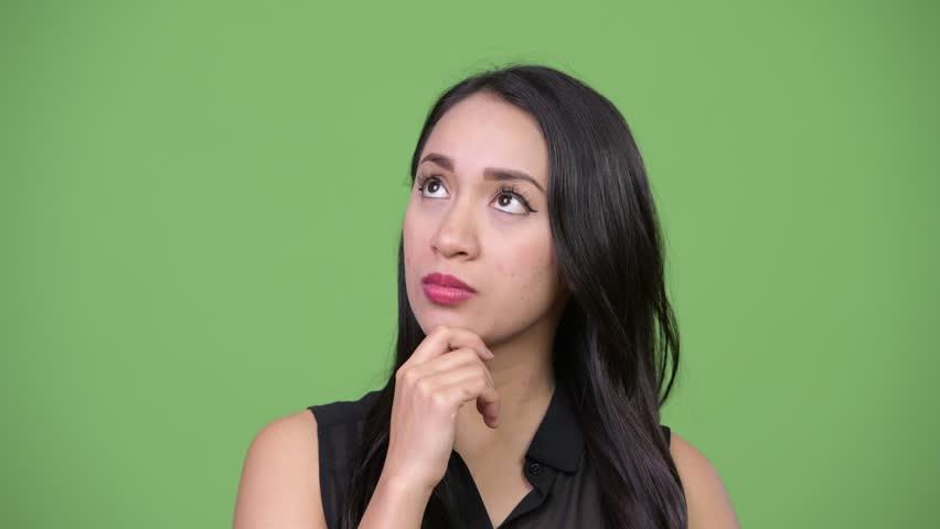 Young beautiful Asian businesswoman thinking | Shutterstock HD Video #1013619185