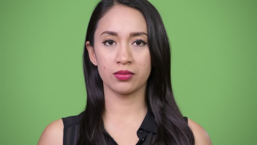 Young beautiful Asian businesswoman with finger on lips | Shutterstock HD Video #1013619452
