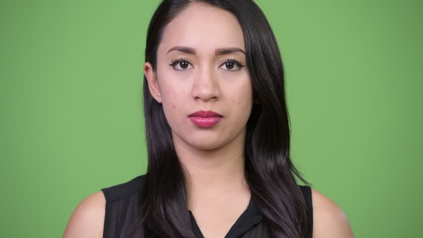 Young beautiful Asian businesswoman against green background | Shutterstock HD Video #1013619467