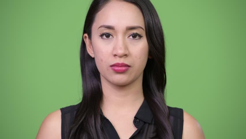 Young beautiful Asian businesswoman looking shocked | Shutterstock HD Video #1013619506