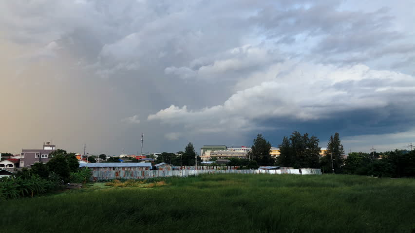 Rain Clouds moving at sunset, fade into night sky.