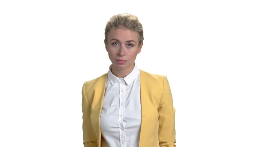 Angry female manager blaming and accusing. Angry mature woman in yellow business suit. White isolated background.