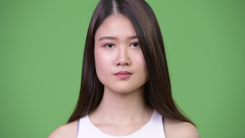 Young beautiful Asian businesswoman covering ears as three wise monkeys concept | Shutterstock HD Video #1013692490