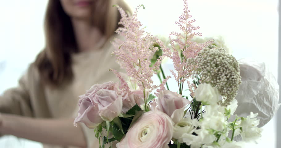 Taking Perfect Flowers for Your Wedding Bouquet. Young florist takes perfect flowers to make a wedding bouquet. Her flowers are wonderful, the colors are so rustic, she has perfect taste  #1013727017