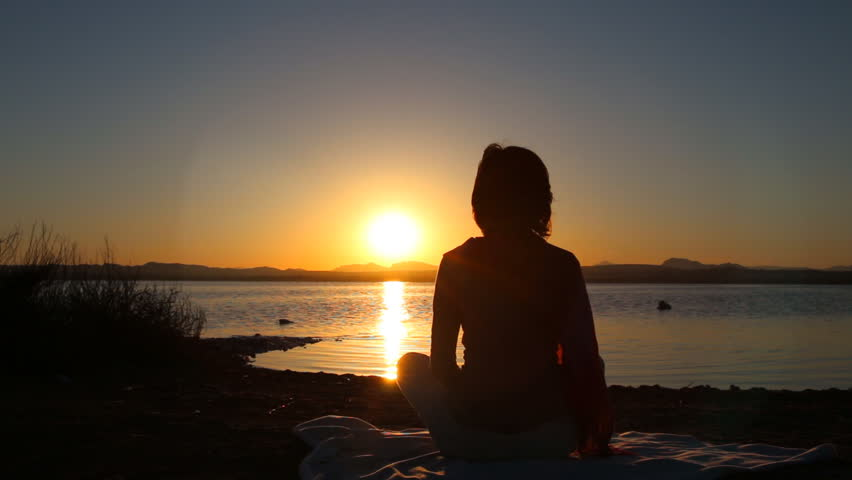 Healthy woman doing exercises over orange sun | Shutterstock HD Video #10137554