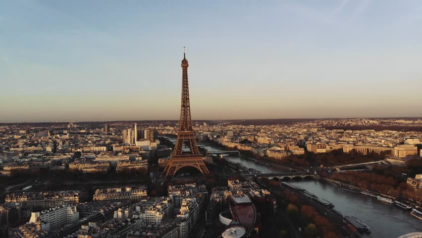 Aerial shot of the Eiffel tower at sunrise. | Shutterstock HD Video #1013776265