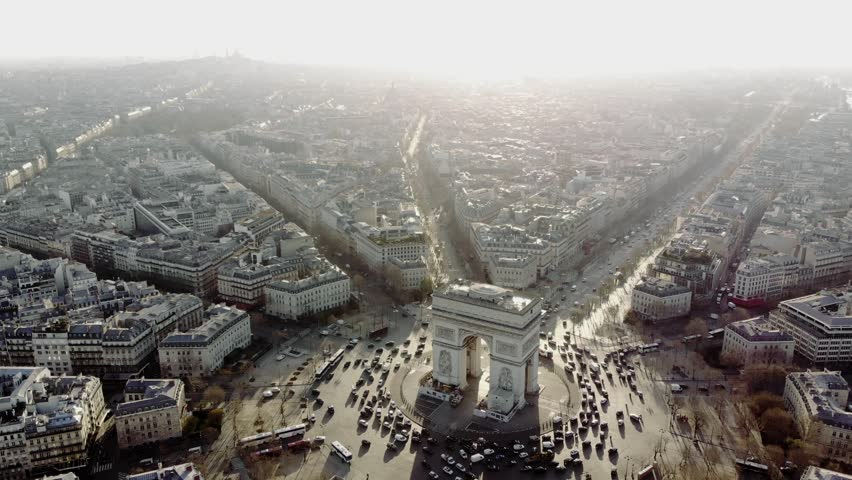 Parisian traffic around the along the Champs Elysees and the Arc de Triomphe in a long and smooth aerial shot. | Shutterstock HD Video #1013776724