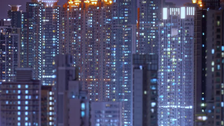 Loop of Hong Kong apartments at night. Chinese crowded city with lights turning on and off at midnight. Fast paced modern Asian night-scape time lapse in urban metropolis.   Shutterstock HD Video #1013780267