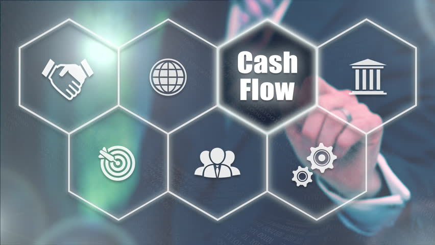 A businessman's hand selecting a Cash Flow concept button on a futuristic computer screen. | Shutterstock HD Video #1013802158