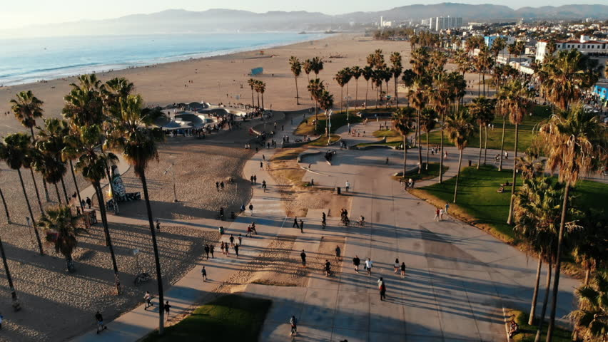 Venice Beach Drone in Los Angeles, CA with beautiful sunshine during summer on the Beachfront Skatepark Skaters Park
