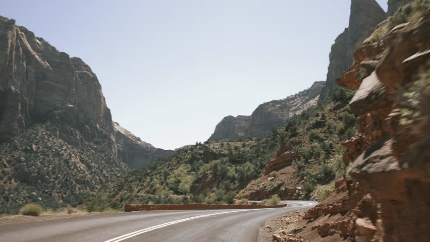 Driving thru rocky road in Zion Park, Utah - Wideing shot, panning around | Shutterstock HD Video #1013850734