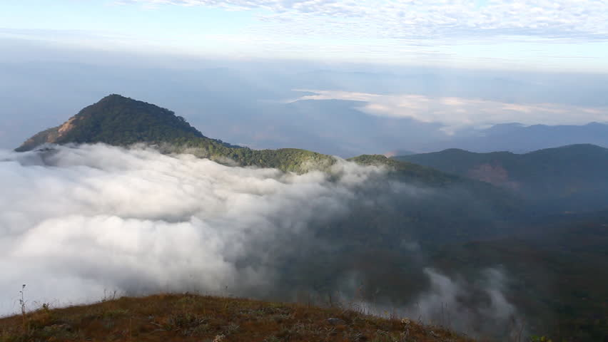 Mist and dew on grassy areas on the highest peak in the morning. Doi mon jong. Chiangmai | Shutterstock HD Video #1013852642