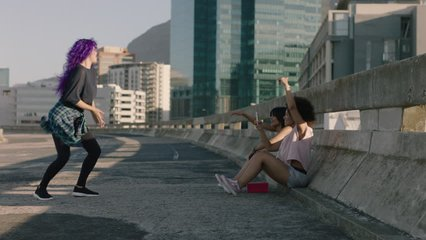 dancing woman young street dancer with purple hair performing contemporary moves friends watching taking video using smartphone enjoying urban freestyle dance