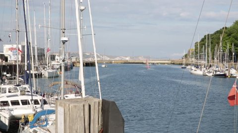 Purbeck cliffs and yachts in marina in England