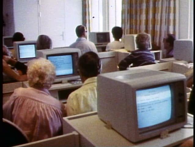QUEEN ELIZABETH 2, 1985, QE2 computer learning center, 1985, medium shot