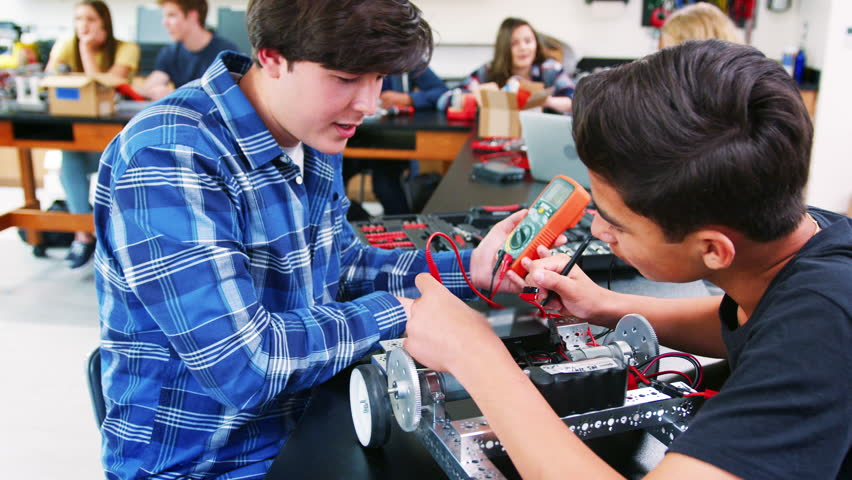 Male High School Pupils Building Robotic Vehicle In Science Lesson | Shutterstock HD Video #1013948780