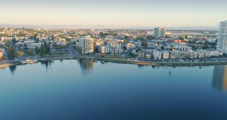 Aerial: Flying over Lake Merritt and residential neighbourhood in Oakland | Shutterstock HD Video #1013970008