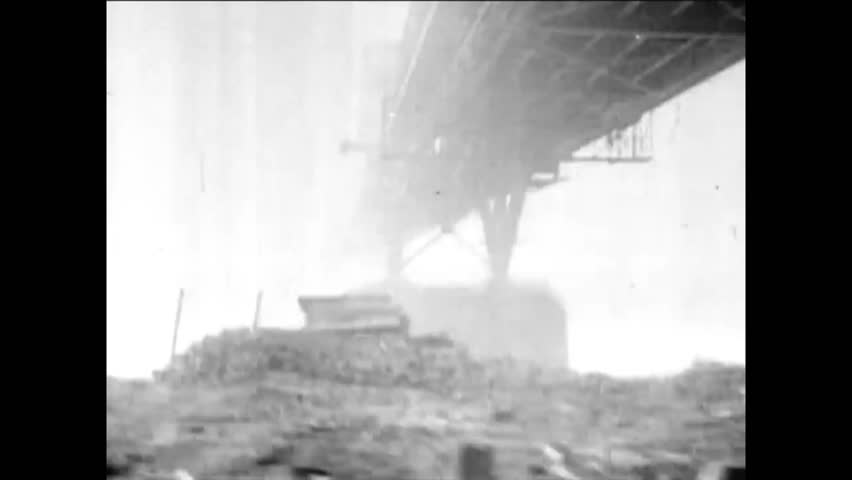 CIRCA 1940s - Allied troops cross the only in tact bridge along the Rhine, the Ludendorff Bridge, near the end of WWII in March 1945.