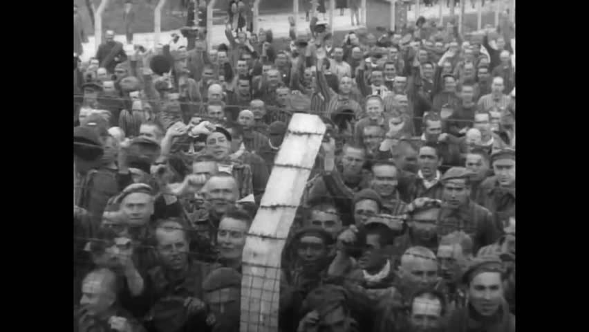 CIRCA 1950s - At the end of the war in 1945, the Seventh Army liberates a Nazi Camp, and remembers those who fell fighting.