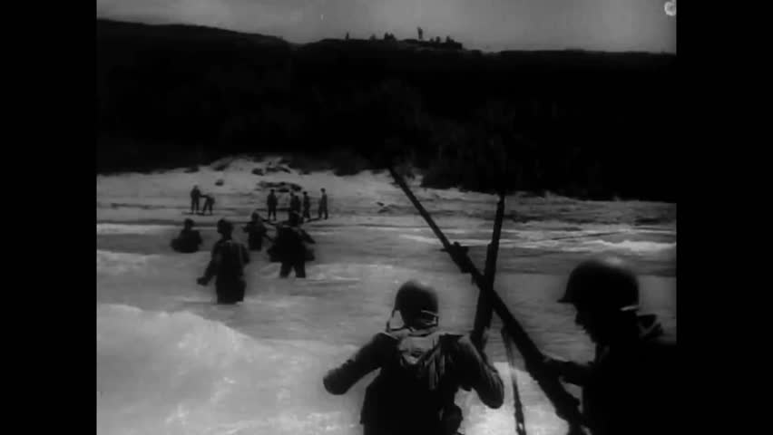 CIRCA 1950s - The Seventh Army successfully lands on the beach of Sicily, Italy, in the invasion of July 1943.